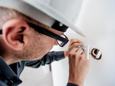 Electrician installing sockets