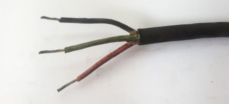 Picture of old electrical wiring colours frayed and needing replaced