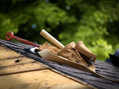 Roofers repairing roofs