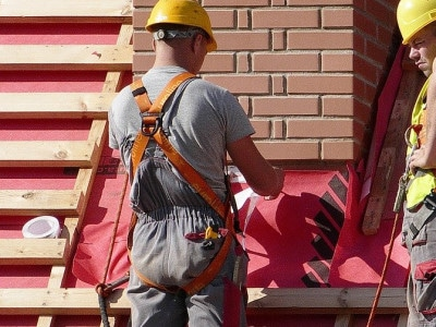 Roofers replacing roof tiles
